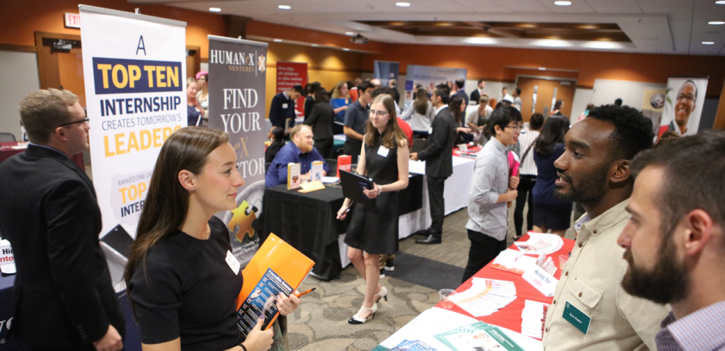 Students engage with alumni recruiters at Recruiting Expo