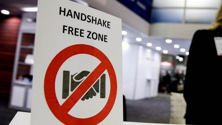 "Door sign that states ""Handshake free zone""."